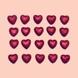 Cukierki wiele czerwoni dekoracyjni cukierków serca odizolowywający na różowym tle Obraz Royalty Free