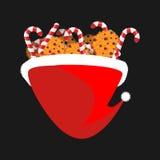 Cukierku ciastko w Santa nakrętce i trzcina Boże Narodzenie mennicy kij Xmas r ilustracja wektor