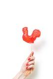 Cukierku Cockerel symbol 2017 na białym tle Zdjęcia Stock