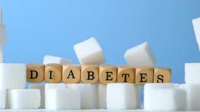 Cukrowi sześciany i kostka do gry literuje cukrzyca spada puszek zbiory wideo