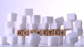 Cukrowi sześciany spada przed kostka do gry literuje out cukrzyce zbiory