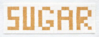 Cukrowi sześciany w teksta formacie Zdjęcie Stock