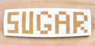 Cukrowi sześciany w teksta formacie Zdjęcia Stock
