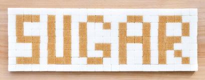 Cukrowi sześciany w teksta formacie Fotografia Royalty Free