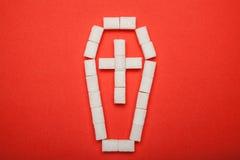 Cukrowy nałóg, pojęcie na czerwonym tle obraz stock