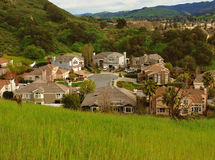 Cul de sac. A cull de sac street in an expensive neighborhood surrounded by hills with lush vegetation Royalty Free Stock Photography