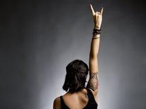 Culbuteur femelle avec le bras en air Images stock