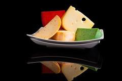 Culinaire kleurrijke kaasvariatie stock afbeeldingen