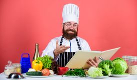 Culinary arts concept. Amateur cook read book recipes. Man learn recipe. Try something new. Cookery on my mind. Improve. Cooking skill. Book recipes. According stock images