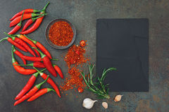 Culinary background with  chili peppers and spices Royalty Free Stock Photo