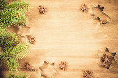 Culinary background. Cutters for cookie, anise and branch of Christmas tree. Royalty Free Stock Photography