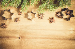 Culinary background. Cutters for cookie, anise and branch of Christmas tree. Royalty Free Stock Photo