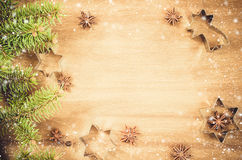 Culinary background. Cutters for cookie, anise and branch of Christmas tree. Royalty Free Stock Images