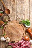 Culinary background with empty cutting board and spices Stock Photo