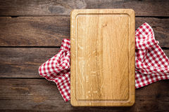 Culinary background. Empty cutting board, view from above Stock Photos