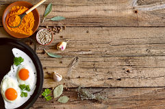 Culinary background. With herbs and fried eggs Royalty Free Stock Photos