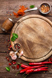 Culinary background. With spices and cutting board stock photography