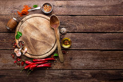 Culinary background. With spices and cutting board royalty free stock photo