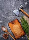 Culinary background with spices, cutting board and hatchet. Top view, copy space Stock Images
