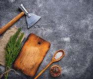 Culinary background with spices, cutting board and hatchet. Top view, copy space Royalty Free Stock Image