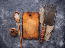 Culinary background with spices, cutting board and hatchet. Top view, copy space Stock Photos