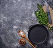 Culinary background with spices, pan and knife. Top view royalty free stock image
