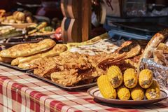 Culinary buffet with a presentation of a variety of healthy food - meat, sausage, grilled vegetables. Kitchen in the open air stock images