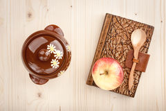 Culinary concept background. Of apple and notebook on wooden table Royalty Free Stock Photography