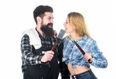 Culinary expert. Tools for roasting meat outdoor. Man bearded hipster and girl. Preparation and culinary. Picnic royalty free stock images