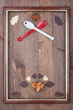 Culinary frame. As the coat of arms on a wooden background Royalty Free Stock Photos