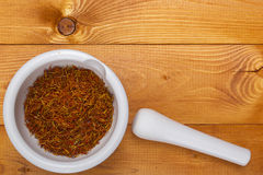 Culinary mortar with spice saffron Stock Images