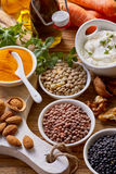 Culinary nuts and spices in bowls. Elevated view of different culinary nuts and spices in bowls Stock Image
