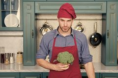 Culinary recipe. Chef cooking vegetarian recipe. Vegetarian cuisine rich vitamins. Man chef wear apron cooking in. Kitchen. Man cook vegetarian recipe with stock image
