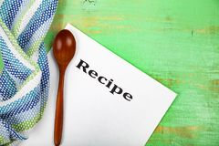 Culinary recipe, towel and spoon Stock Photography