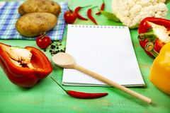 Culinary recipe, towel, spoon and various vegetables Royalty Free Stock Photography
