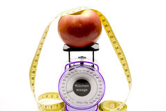 Culinary scales with apple Stock Photography