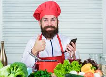 Culinary school. Hipster in hat and apron learning how cook online. Culinary education online. Elearning concept. Man. Chef searching internet recipe cooking royalty free stock image