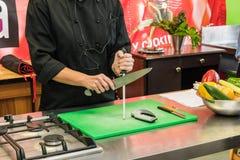 Culinary school knife skills training Stock Photo