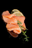 Culinary seafood. Salmon pieces on black. Stock Photos