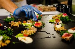 Culinary show- preparing several dishes Royalty Free Stock Photo