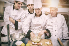 Culinary students learning how to mix dough. In kitchen royalty free stock photo