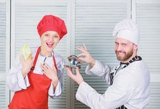 Culinary surprise concept. Delicious meal. Woman and bearded man culinary show team. Ultimate cooking challenge royalty free stock image