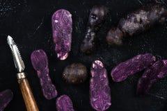 Culinary trends, purple potatoes Stock Photo