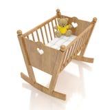 Culla di legno del bambino con il giocattolo dell'orso isolato su fondo bianco Fotografie Stock Libere da Diritti