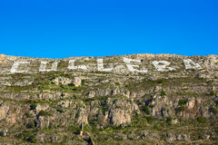 Cullera mountain with white sign writed on in Stock Image