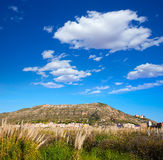 Cullera mountain with white sign writted on in Stock Image