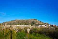 Cullera mountain with white sign writted on in Stock Photos