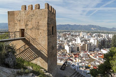Cullera. Valencia. Ancient tower and aerial view of the town of Cullera. Valencia Royalty Free Stock Photography