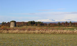 Culloden Moor with Winter Mountains and Cairn. View of Culloden Moor, memorial Cairn or grave for the clans and snow capped mountains in the background in an royalty free stock photo