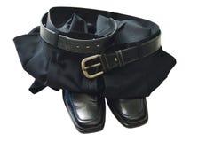 Culotte d'affaires et chaussure noires de mousse sur le fond blanc Photos libres de droits
